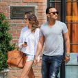 John Legend a la sortie de son hôtel avec sa petite amie Christine Teigen a New York, le 30 juillet 2013.