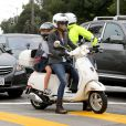 Exclusive - Gwyneth Paltrow and her husband Chris Martin take their little ones Apple and Moses to school. The couple drove side-by-side on their Vespas with their kids behind them and stopped at a busy intersection. Los Angeles, CA, USA, September 11, 2013. Photo by GSI/ABACAPRESS.COM12/09/2013 - Los Angeles