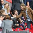 Jean Sarkozy et Pierre Sarkozy lors du match de football PSG - Toulouse au Parc des princes, le 28 septembre 2013