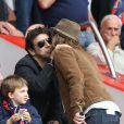 Patrick Bruel et Pierre Sarkozy lors du match de football PSG - Toulouse au Parc des princes, le 28 septembre 2013