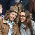 Pierre Sarkozy et son amie lors du match de football PSG - Toulouse au Parc des princes, le 28 septembre 2013