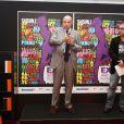 """Jean-Marie Le Guen lors de l'inauguration de l'exposition """"Sex in the city"""" à l'initiative de Solidarité Sida sur la place de la Bastille à Paris, le 7 octobre 2013."""