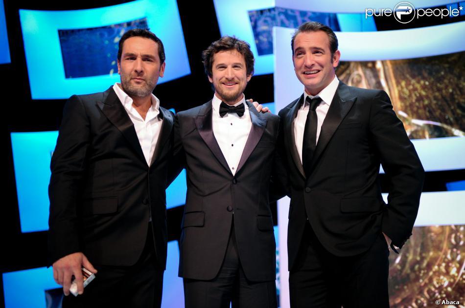 Gilles Lellouche, Guillaume Canet et Jean Dujardin à Paris lors des César le 24 février 2012.