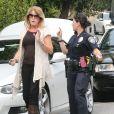 David Beckham impliqué avec son fils Brooklyn dans un accident de voiture entre un Acura SUV et son Range Rover Sport devant sa maison de Beverly Hills, à Los Angeles le 25 octobre 2013.