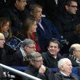 Manuel Valls, sa femme Anne-Gravoin, Pierre Moscovici et sa compagne Marie-Charline Pacquot lors du match entre la France et la Nouvelle-Zélande au Stade de France à Saint-Denis, le 9 novembre 2013