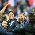 Bacary Sagna, Mathieu Valbuena, Samir Nasri, Olivier Giroud, Karim Benzema, Raphael Varane et Paul Pogba après la victoire de l'équipe de France face à l'Ukraine (3-0), qui la qualifie pour le mondial 2014 au Brésil, le 19 novembre 2013 au Stade de France à Saint-Denis