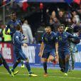 Karim Benzema, Paul Pogba et Blaise Matuidi après la victoire de l'équipe de France face à l'Ukraine (3-0), qui la qualifie pour le mondial 2014 au Brésil, le 19 novembre 2013 au Stade de France à Saint-Denis