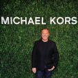 Michael Kors arrive à l'ouverture de la boutique Michael Kors à Milan le 4 décembre 2013