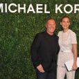 Michael Kors, Bar Refaeli arrivent à l'ouverture de la boutique Michael Kors à Milan le 4 décembre 2013