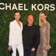 Karmen Pedaru, Michael Kors, Carmen Kass arrivent à l'ouverture de la boutique Michael Kors à Milan le 4 décembre 2013