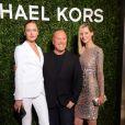 Karmen Pedaru, Michael Kors et Carmen Kass arrivent à l'ouverture de la boutique Michael Kors à Milan le 4 décembre 2013