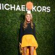 Anna Dello Russo arrive à l'ouverture de la boutique Michael Kors à Milan le 4 décembre 2013