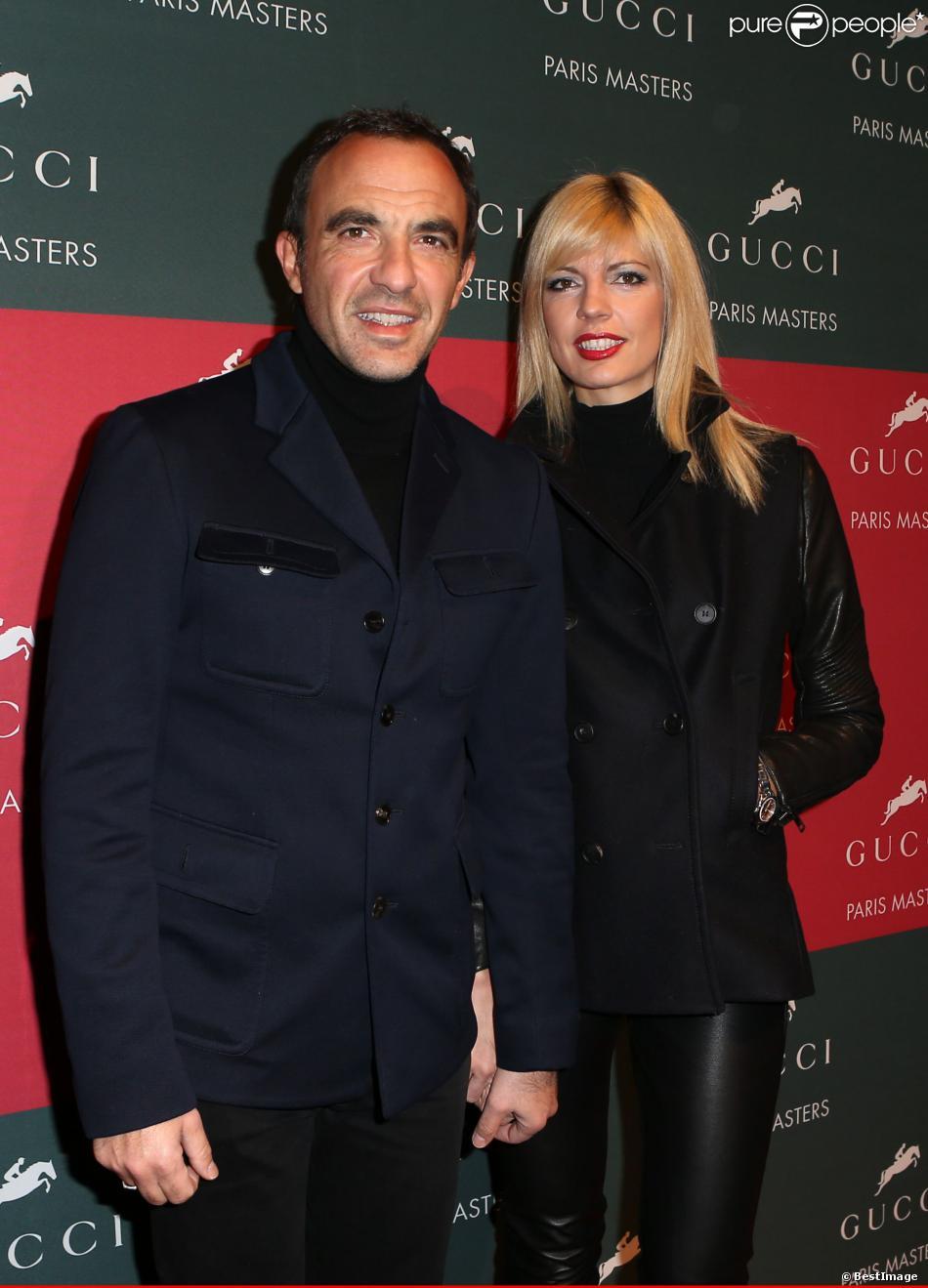 Nikos Aliagas et sa compagne Tina Grigoriou lors de l'épreuve Style & Competition for AMADE aux Gucci Masters de Villepinte le 7 décembre 2013