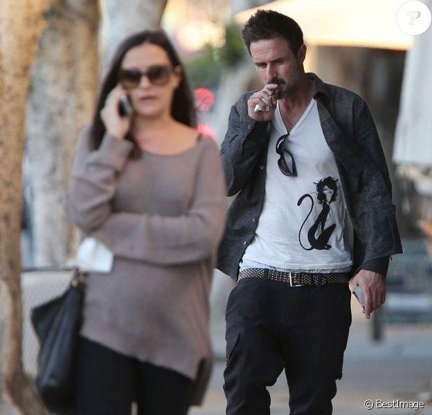 Exclusif - David Arquette et sa petite amie Christina McLarty, enceinte, font du shopping à West Hollywood, le 23 décembre 2013.