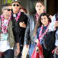 Prince et son frère Blanket, accompagnés de leurs cousins Jermajesty et Jaafar Jackson, arrivent à Honolulu, le 23 décembre 2013.