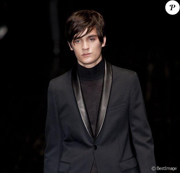 Alain-Fabien Delon défile pour la maison Gucci lors de la Fashion Week à Milan le 13 janvier 2014