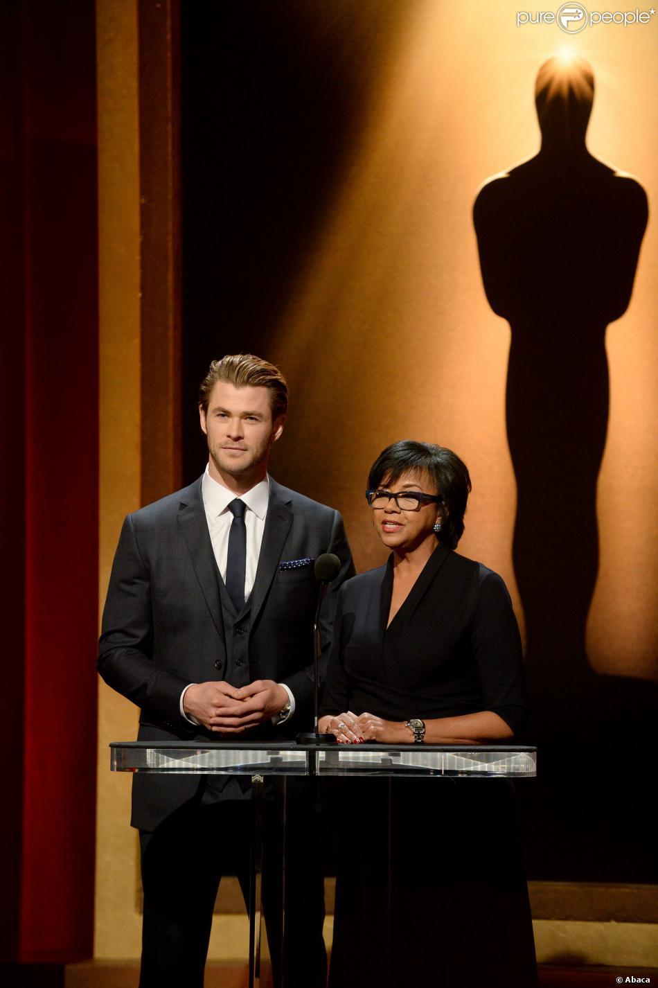 Chris Hemsworth et Cheryl Boone Isaacs aux nominations des Oscars 2014 à Beverly Hills, Los Angeles, le 16 janvier 2014.