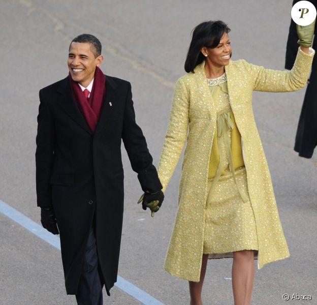 Barack et Michelle Obama défilent lors de la cérémonie d'investiture du président à Washington. Janvier 2009.