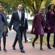 Barack Obama, son épouse Michelle et leurs deux filles Malia (à gauche) et Sasha quittent l'église St John. Washington, le 27 octobre 2013.