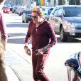Johnny Hallyday se rend au restaurant The Ivy avec son ami François Vincentelli aà Los Angeles, le 16 janvier 2014.