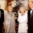 Le duc d'Edimbourg, Jacques Chirac, Bernadette et Elizabeth II au château de Windsor, le 18 novembre 2004.
