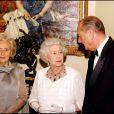 Jacques Chirac, Bernadette et Elizabeth II au château de Windsor, le 18 novembre 2004.