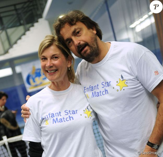 Michèle Laroque et Henri Leconte lors du lancement de l'opération Sourire gagnant de l'association Enfant Star & Match à Levallois-Perret le 10 février 2014