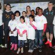 Henri Leconte, Michelèle Laroque, Pierre Ménès, Pierre Douglas lors du lancement de l'opération Sourire gagnant de l'association Enfant Star & Match à Levallois-Perret le 10 février 2014