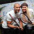 Tatiana et Xavier Delarue lors du lancement de l'opération Sourire gagnant de l'association Enfant Star & Match à Levallois-Perret le 10 février 2014