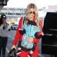 Fergie à l'aéroport de Los Angeles avec son fils Axl, le 10 février 2014.