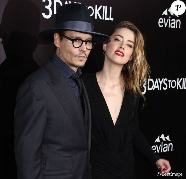 """Johnny Depp et sa fiancée Amber Heard à l'avant-première de """"3 Days to Kill"""" à Los Angeles, le 12 février 2014."""