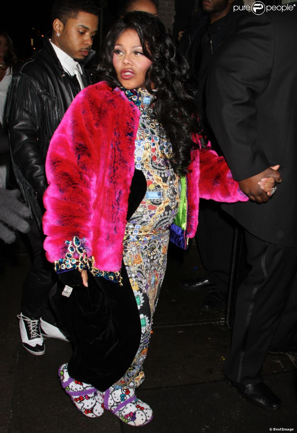 Lil Kim, enceinte, lors de la fashion week à New York, le 12 février 2014.