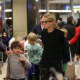Exclusif - Sharon Stone avec ses enfants à l'aéroport de Paris, le 30 novembre 2013.