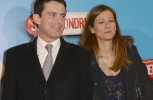 Manuel Valls et sa femme Anne Gravoin applaudissent le Supercondriaque Dany Boon