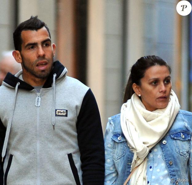 Carlos Tevez et sa femme Vanessa, enceinte, à Milan le 24 février 2014.