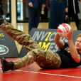 """ Le prince Harry en pleine partie de volley-ball assis au Queen Elizabeth Park le 6 mars lors de l'annonce officielle des 1ers Invictus Games, jeux paralympiques militaires qui se tiendront du 10 au 14 septembre 2014. """