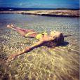Renae Ayris en pleine séance photo à Sydney. Le 11 mars 2014.