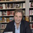 Jean-Jacques Bourdin à la 34e édition du Salon du Livre à Paris, Porte de Versailles, le 22 mars 2014.