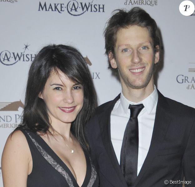 Romain Grosjean et sa femme Marion Jollès lors du dîner de Gala du 92e Grand Prix d'Amérique au Grand Palais à Paris le 26 janvier 2013