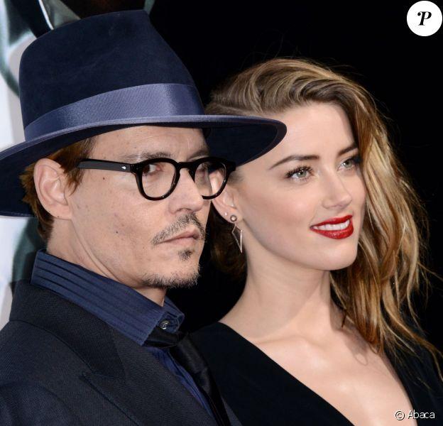 Johnny Depp et Amber Heard lors de l'avant-première du film 3 Days To Kill à Los Angeles le 12 février 2014