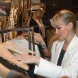 """Laeticia Hallyday au cocktail dinatoire pour le lancement de la capsule Sarah Lavoine et Juliette Swildens, associées toutes les deux pour créer une collection capsule """"Around the clock!"""", à la boutique Swildens au 18, rue du Vieux Colombier, à Paris."""