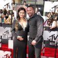 Jenni Farley et Roger Mathews sur le tapis rouge de la cérémonie des MTV Movie Awards à Los Angeles, le 13 avril 2014.