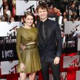 Shailene Woodley et Ansel Elgort sur le tapis rouge de la cérémonie des MTV Movie Awards à Los Angeles, le 13 avril 2014.