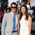 Johnny Knoxville et son épouse sur le tapis rouge de la cérémonie des MTV Movie Awards à Los Angeles, le 13 avril 2014.