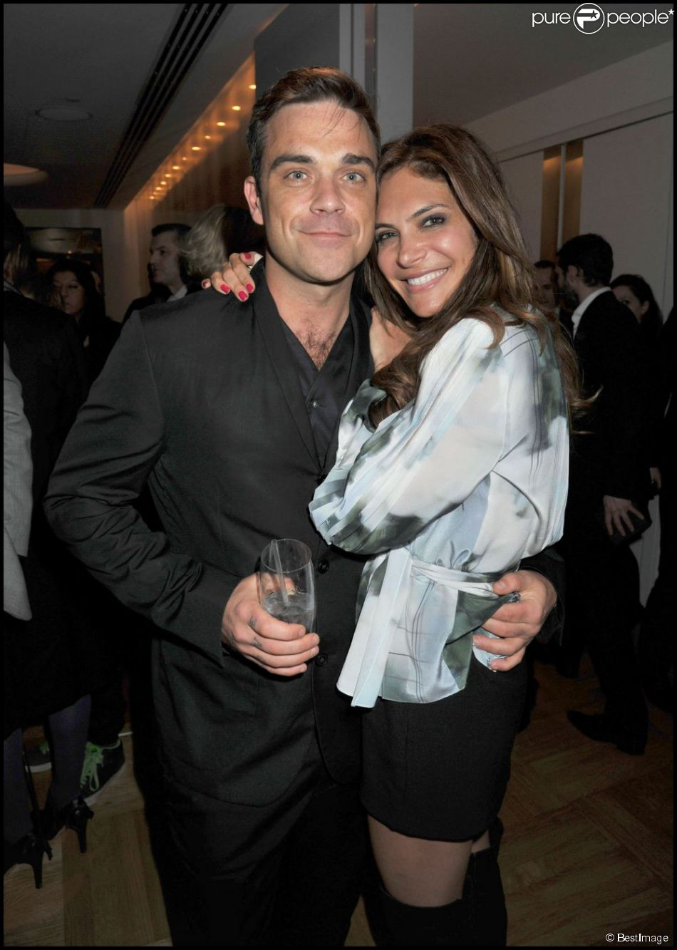 Robbie Williams et sa femme Ayda Field à la soirée Spencer Hart au Selfridge's à Londres, le 10 février 2011.