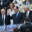 Noël Le Graët, François Hollande, et Claude Bartolone assistent à la finale de la Coupe de France entre le Stade Rennais et Guingamp, à Saint-Denis, près de Paris, le 3 mai 2014.