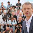 Lambert Wilson, maître de cérémonie - Photocall du 67e Festival International du Film de Cannes, le 14 mai 2014