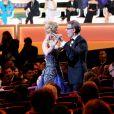 Nicole Kidman et Lambert Wilson s'offrent une danse pendant la cérémonie d'ouverture du 67e festival international du film de Cannes, le 14 mai 2014.