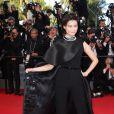 """Li Yuchun pour la montée des marches du film """"Sils Maria"""" lors du 67 ème Festival du film de Cannes – Cannes le 23 mai 2014"""