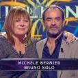 Michèle Bernier et Bruno Solo dans Qui veut gagner des millions ? sur TF1, le vendredi 23 mai 2014.